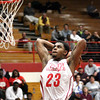 Jeffersonville senior Darryl Baker cocks the ball behing his head en route to a dunk against Jennings County Thursday night. Staff photo by C.E. Branham