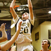Henryville forward Tyler Collins goes up for a shot during their game against Crawford County at the Crawford County Sectional on Tuesday. Crawford County won the game, 82-46. Staff photo by Christopher Fryer