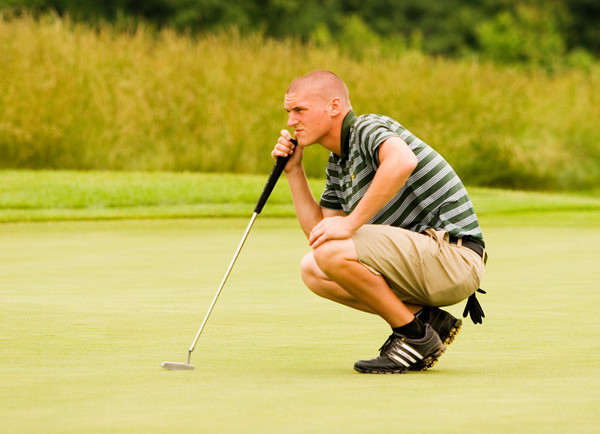 Floyd Central's Daniel Shepard studies the green before putting on the eighth green at Champions Pointe Golf Club during the Providence regional tournament on Thursday morning. Staff photo by Christopher Fryer