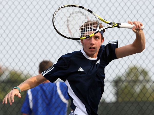 Providence no.1 singles player Robert Carrico returns volley to Jeffersonville player Jordy Rigsby in the Jeffersonville Tennis Sectional on Wednesday. Staff photo by C.E. Branham