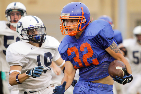 Silver creek running back Brad Graham moves the ball down field during their scrimmage at Providence on Friday