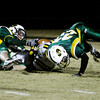 Floyd Central defensive backs Logan Vaughn, left, and Gavin Horner attempt to stop Castle wide receiver Jon-Marc Anderson during the first half of their game in the Class 5A Football Sectional at Floyd Central on Friday. Anderson scored on the play. Staff photo by Christopher Fryer