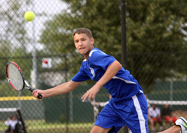 New Washington no. 1 singles player Jake Zimmerman makes a return to Clarksville player Austin Johnson in the Jeffersonville Tennis Sectional semi-finals. Staff photo by C.E. Branham