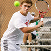 Jeffersonville junior Austin Hunt moves to return a shot during his No. 1 singles match against Floyd Central senior Ryan Plunkett on Wednesday at Floyd Central. Staff photo by Christopher Fryer