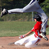Jeff/GRC 13-14 All-Star Jordan Thomas slides in to steal second after a bad throw by HYR in District V tourney play Monday evening in Charlestown. Staff photo by C.E. Branham