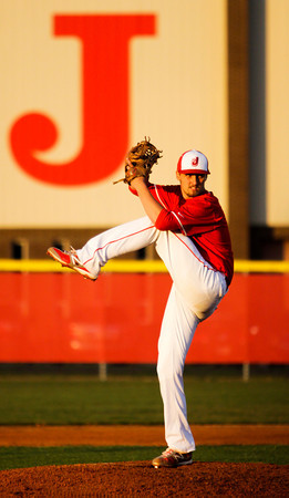 Jeffersonville's Chandler Dale pitches during the Red Devils' home game against Floyd Central on Wednesday. Staff photo by Christopher Fryer