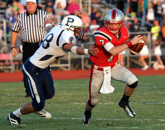 Jeffersonville quarterback Tyler Fridley slips by Providence defender Nick Hayes for a scrambling eight-yard touchdown Friday night. Staff photo by C.E. Branham