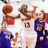 New Albany guard Leondre McBirth goes up for a shot during the Bulldogs' home game against Scottsburg on Saturday. New Albany won the game, 77-59. Staff photo by Christopher Fryer