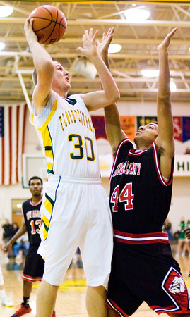 Floyd Central forward Zane Nichols goes up for a shot during the Highlanders' home game against New Albany on Friday. New Albany won the game 49-45. Staff photo by Christopher Fryer