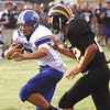 Charlestown quarterback Aaron Daniel fends off Clarksville defender Cameron Hopson for a 13 yard touchdown run Friday night. Staff photo by C.E. Branham