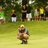 Floyd Central senior Devin Jenkins studies the green before putting on the 17th hole during the final round of the state golf tournament at the Legends Golf Club in Franklin on Wednesday afternoon. Jenkins finished individually as the state runner-up with a score of 137, and Floyd Central finished as a team in third place with an overall score of 580. Staff photo by Christopher Fryer