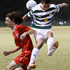 Jeffersonville defender Damon Rhodes and Floyd Central midfielder Zach Lewis collide as they fight for possession of the ball during the first half of their game at Floyd Central on Wednesday. Play was postponed due to weather with just over 15 minutes left in the first half and the score tied at one. The match will resume on Friday at Floyd Central. Staff photo by Christopher Fryer