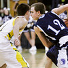 Providence guard Ben Shahroudi faces off with Floyd Central guard Travis Foster during their game at Floyd Central on Saturday. Providence won the game, 43-31. Staff photo by Christopher Fryer