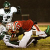 Jeffersonville wide receiver Ricky Embry is taken down by Evansville North safety Justin Lockett during the first quarter of their game at Jeffersonville on Friday. Staff photo by Christopher Fryer
