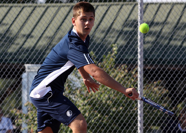 Providence no. 1 singles player Will Andres chases down a return from Silver Creek player Jake Steele in their match Tuesday. staff photo by C.E. Branham