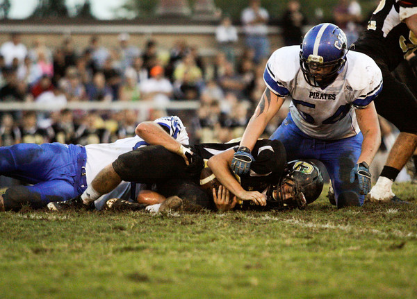Charlestown senior Cole Nokes and junior Jake Harper bring down Corydon Central junior Alex McAfee during the first quarter of their game in Corydon on Friday. Staff photo by Christopher Fryer
