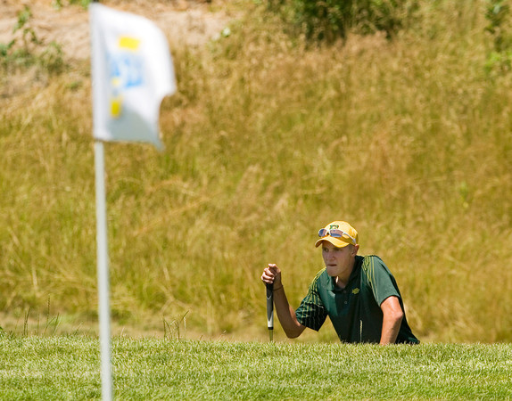 Floyd Central High School senior Jay Holderman studies the green before putting on the 16th hole during the Indiana High School State Athletic Association Boys Golf State Finals at The Legends Golf Club in Franklin on Tuesday afternoon. Staff photo by Christopher Fryer