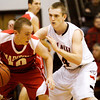 New Albany forward Jeff Byrne covers Madison guard Willie Huffman during their game in New Albany on Friday. Staff photo by Christopher Fryer