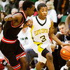Floyd Central guard Myles Ervin drives the ball down court during the Highlanders' home game against New Albany on Friday. New Albany won the game 49-45. Staff photo by Christopher Fryer