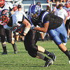 Charlestown defensive end Darren Taylor making a stop against Brownstown Central. Staff photo by C.E. Branham