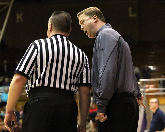 Jeffersonville coach Chad Gilbert discusses with an official one of the 45 fouls called in the sectional game between Jeff and Bedford North Lawrence Friday night in Seymour. Staff photo by C.E. Branham
