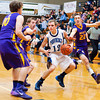 Providence guard Ben Shahroudi moves the ball down court during the Pioneers' home game against Scottsburg on Saturday. Providence won the game, 51-43. Staff photo by Christopher Fryer