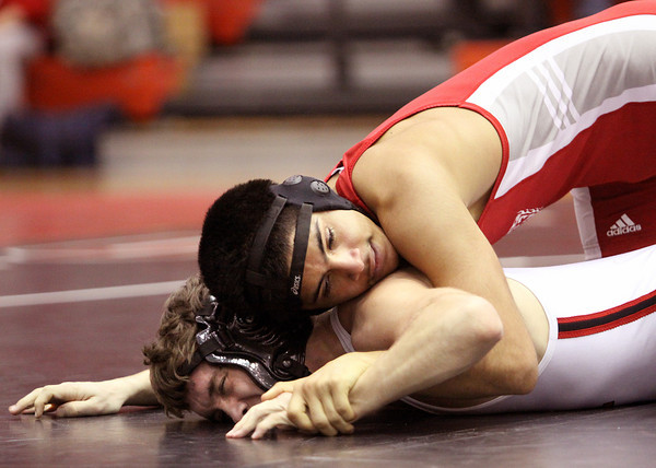 Jeffersonville wrestler Jojo DeLeon, top, and New Albany wrestler Chase Laughead in the 120 pound match Wednesday night at New Albany. DeLeon won by a 17-6 decision. Staff photo by C.E. Branham