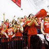 Jeffersonville fans cheer as the Red Devils' starting line up is announced before the start of their game at New albany on Friday. New Albany won the game, 67-56. Staff photo by Christopher Fryer