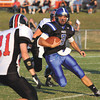 Charlestown quarterback Aaron Daniel weaves through the Brownstown Central defense for 24 yards and a first down. Staff photo by C.E. Branham
