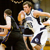 Providence center Nick Hayes covers Christian Academy sophomore Aaron Eldridge during their game at Providence on Friday. Staff photo by Christopher Fryer