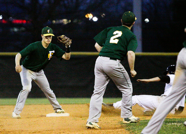 Floyd Central's Connor Curry, center, and Jacob Snodgrass, left, force an out at second during their game at New Albany on Wednesday. Staff photo by Christopher Fryer