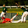 Floyd Central's Michael Springer tags out Jeffersonville's Jeremiah Phelps at second base on an attempted steal during the Red Devils' 7-6 victory at Floyd Central on Monday. Staff photo by Christopher Fryer
