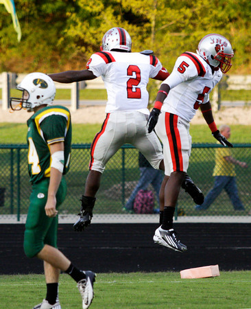 Jeffersonville running back Austin Hines, left, and wide receiver Jacquari Chandler celebrate after Hines scored a touchdown in the first quarter of their away game against Floyd Central on Friday. Staff photo by Christopher Fryer