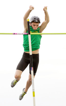 Floyd Central junior Jacob Marguet clears the bar at 13 feet and seven inches to break the sectional record during the Floyd Central sectional track meet on Thursday. Marguet went on to break the school record with a vault of 14 feet. Staff photo by Christopher Fryer