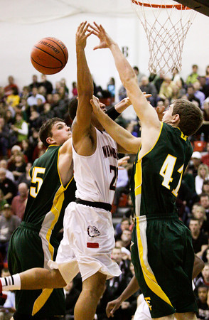 New Albany guard Jermaine Parrish is fouled while going up for a shot during their game against Floyd Central on Friday. Staff photo by Christopher Fryer