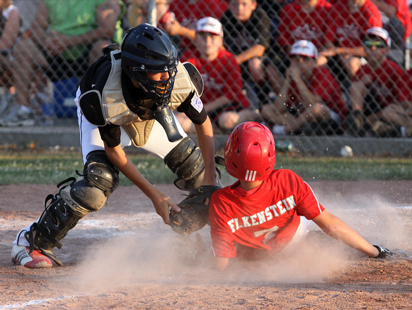 New Albany 11-12 All-Star catcher Blake Murphy tags Jeff/GRC runner Bailey Falkenstein for an out Friday night in District V play. The Jeff/GRC 11-12 team advanced to 2-0 with a 4-2 win. Staff photo by C.E. Branham