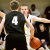 Providence guard Nano Grantz covers Clarksville guard Calvin McEwen during their game at Providence on Friday. Staff photo by Christopher Fryer
