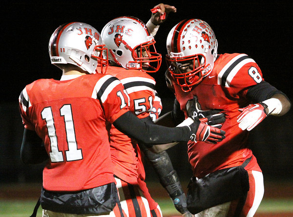 Jeffersonville receiver Dionte Allen is congratulated by teammates Jay Brown (51) and Ricky Embry (11) after Allen pulled in his second touchdown reception of the first half Friday night against New Albany in 5A Sectional play. Staff photo by C.E. Branham