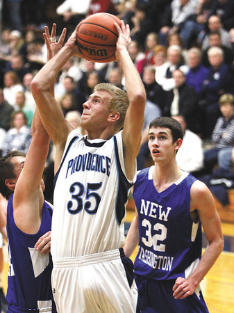 Providence junior Grant Goad puts up a shot against New Washington Friday night. Staff photo by C.E. Branham