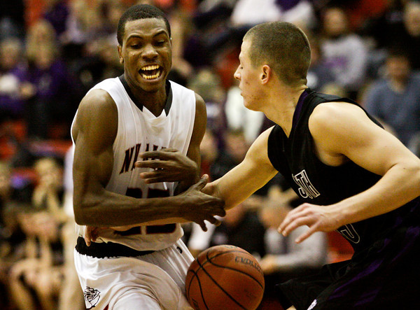 New Albany guard Leondre McBirth struggles for possession of the ball during their home game against Bloomington South on Saturday. New Albany won the game, 61-57. Staff photo by Christopher Fryer