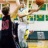 Floyd Central guard J.C. Kinnaird goes up for a shot during the Highlanders' home game against Brownstown Central on Tuesday. Staff photo by Christopher Fryer