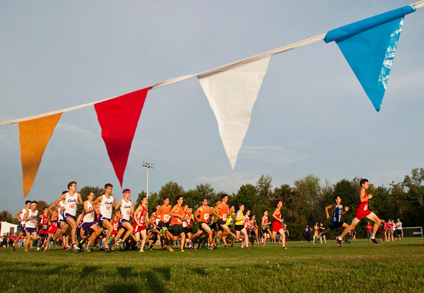 Runners leave the starting line at the beginning of the men's race during the Hoosier Hills Conference cross country meet at Prosser on Saturday morning. Staff photo by Christopher Fryer