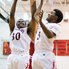 New Albany junior DeAnthony Warren fights for a rebound during the Bulldogs' home game against Jeffersonville on Friday. New Albany won the game, 67-56. Staff photo by Christopher Fryer