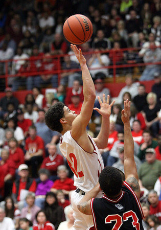 Jeffersonville junior Keenan Williams scores in the paint against New Albany Friday night. Staff photo by C.E. Branham