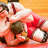 New Albany junior Patrick Landrum wrestles Corydon Central junior David Brann during their 220-pound match at the Jeffersonville Sectional on Saturday. Landrum took the match in a 3-0 decision win over Brann. Staff photo by Christopher Fryer