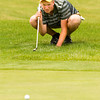 Floyd Central junior Connor Welch studies the green before putting on the 16th hole during the final round of the state golf tournament at the Legends Golf Club in Franklin on Wednesday afternoon. Welch finished individually with a score of 157, and Floyd Central finished as a team in third place with an overall score of 580. Staff photo by Christopher Fryer