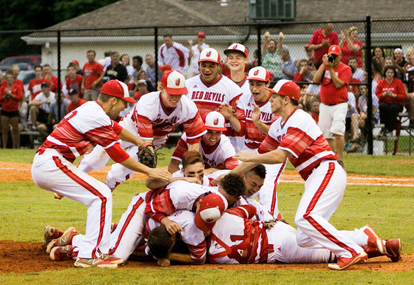 Jeffersonville players celebrate after the Red Devils' 7-1 victory over New Albany in the championship game of the New Albany Sectional on Monday. Staff photo by Christopher Fryer