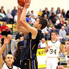 Christian Academy senior Aaron Hayes pulls up for a jumper at Henryville on Tuesday night. Staff photo by C.E. Branham