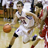 Silver Creek's Zach Davidson drives the ball down court during their home game against Jeffersonville on Friday. Staff photo by Christopher Fryer