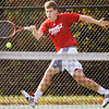 Jeffersonville junior Austin Hunt moves to return a shot to Jasper senior Eli Seng during their No. 1 singles match at the Jasper Semistate on Saturday. Hunt lost the match in two sets, 6-1, 6-2. Staff photo by Christopher Fryer